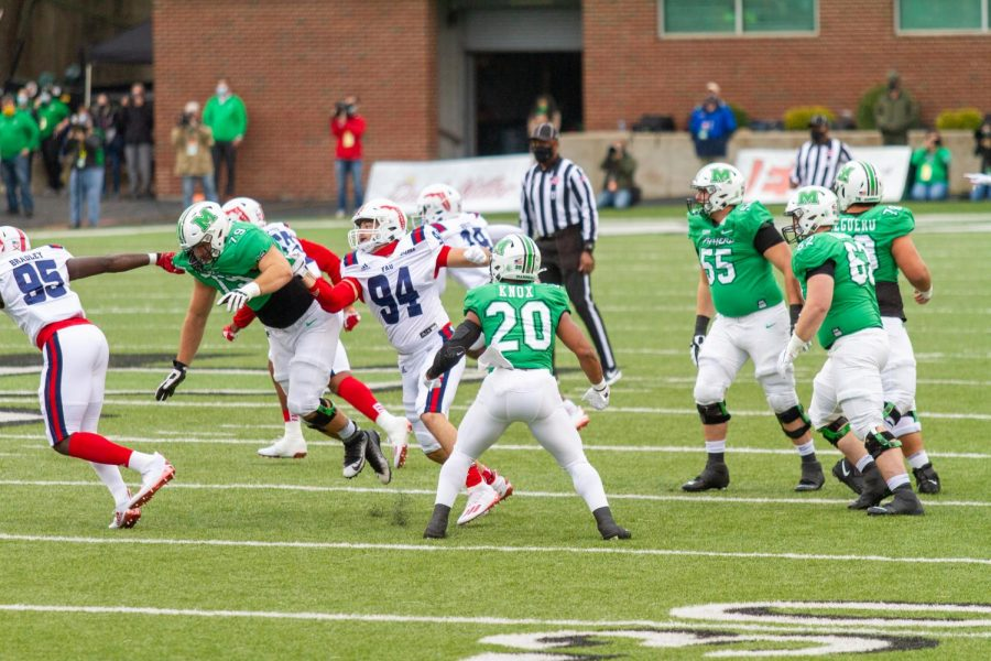 The Marshall University football team's offense attempts to make an offensive play agains the FAU Owls during its Homecoming Game on Saturday, Oct. 24.