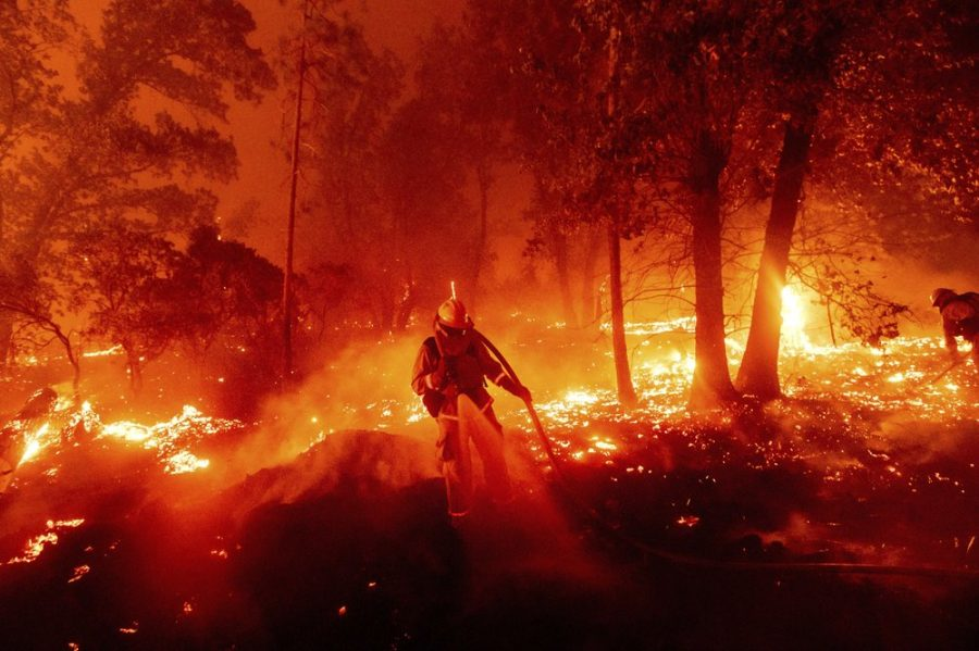 A+firefighter+battles+the+Creek+Fire+as+it+threatens+homes+in+the+Cascadel+Woods+neighborhood+of+Madera+County%2C+Calif.%2C+on+Monday%2C+Sept.+7%2C+2020.+%28AP+Photo%2FNoah+Berger%29