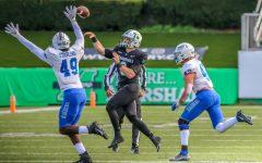 Marshall quarterback Grant Wells throws a pass over MTSU's defensive back Jorden Starling (49) on Nov. 14