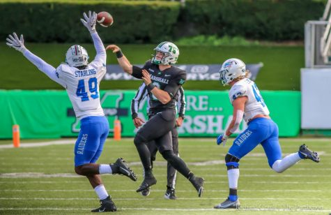 Marshall quarterback Grant Wells throws a pass over MTSU's defensive back Jorden Starling (49) on Nov. 14