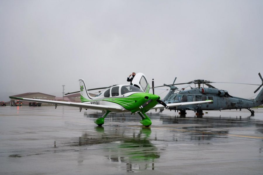 Bill Noe, school's namesake, emerges from the first plane delivered to the Bill Noe Flight School of Marshall University after flying it from the manufacturer.
