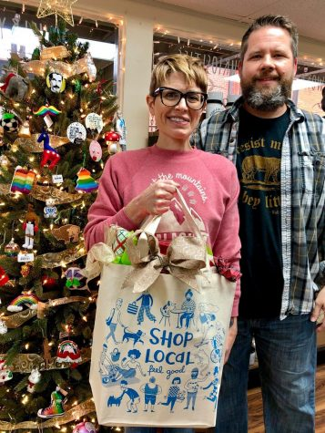 Full Circle Gifts and Goods (from their Facebook), Noelle and Scott Horsfield (owners) are pictured.