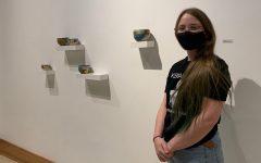 Bree Black with art display. Courtesy Bree Black.