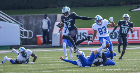 Marshall wide receiver Artie Henry jumped over Middle Tennessee State to avoid being tackled.