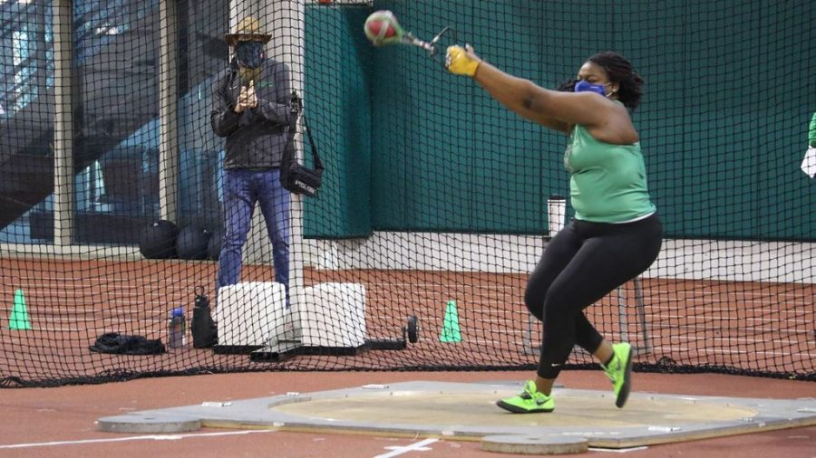 MaryAnn Adebayo tosses a weight during the Marshall classic on Saturday, Feb. 6.