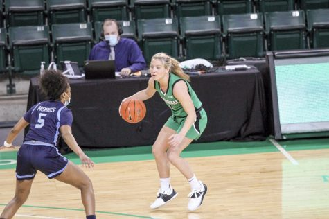 Sophomore guard Savannah Wheeler dribbles beyond the three-point line against Old Dominion on Feb. 5.
