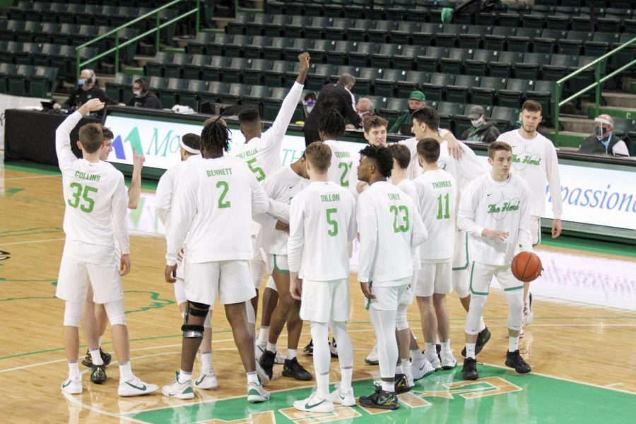 The Marshall men's basketball team gathers near the free-throw line during warmups prior to its contest against Middle Tennessee on Friday, Feb. 12.