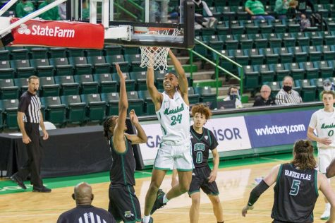 Junior guard Taevion Kinsey goes up for a dunk against Ohio University on Dec. 13.
