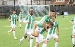 Members of the Marshall University soccer team celebrate Vitor Dias' game-winning goal against Bowling Green Feb. 27.
