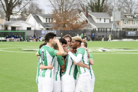 Members of the Marshall men's soccer team huddle up during a match with Bowling Green on Feb. 27.