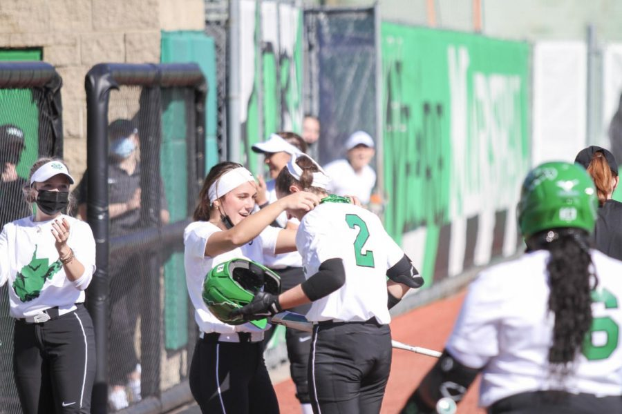 Freshman centerfielder Paige Halliwill celebrates with her teammates after her first career homerun against Akron Wednesday, March 3.