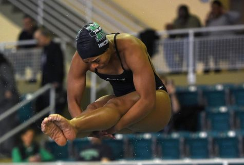 Joelle Williams during a diving competition. | Photo Courtesy of MU Athletics