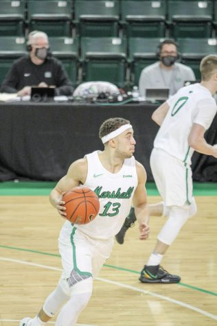 Jarrod West brings the ball up the court against North Texas Friday, Feb. 26 in one of his final appearances in the Cam Henderson Center. West injured his ankle in the contest, missing the following day's game - the only missed game of his career.
