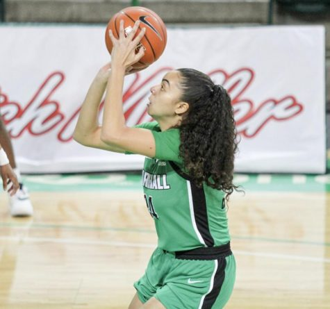 Graduate student Kennedi Colclough pulls up for a jumper around the free throw line against Old Dominion on Friday, Feb. 5.