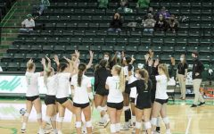 The Marshall volleyball team gathers in- between sets against Western Kentucky. The Thundering Herd and Hilltoppers matched up in Huntington for two matches on Feb. 28 and March 1. The nationally-ranked Hilltoppers won both matches.