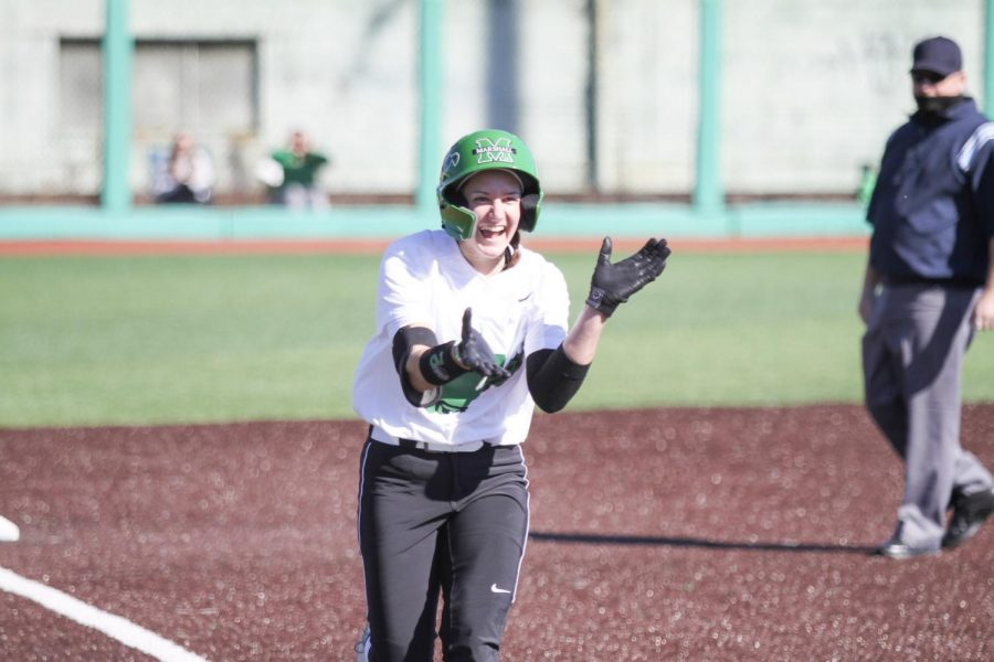 Freshman center fielder Paige Halliwill celebrates as she rounds third after her first career home run against Akron on Wednesday, Mar. 3.