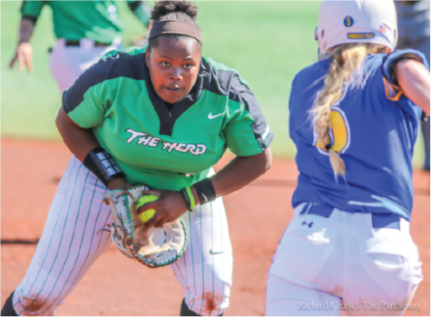 Marshall first baseman Aly Harrell (43) attempts to tag out a Morehead State baserunner during the teams' matchup at Dot Hicks Field on April 11, 2018.