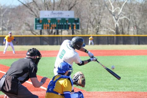 Freshman catcher Ryan Leitch swings at a pitch against Morehead State on Sunday, March 7. Marshall lost the contest 6-2.