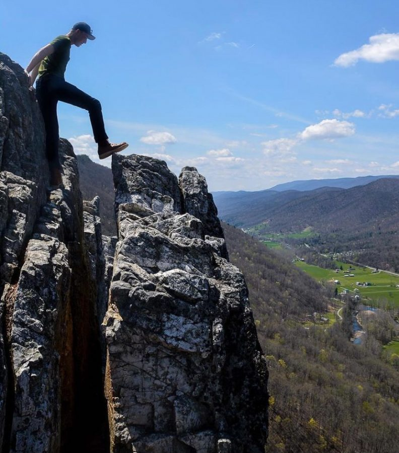 Man steps on top of mountain at Seneca Rocks, West Virginia. | Photo courtesy of Austin O'Connor (@Oco_photo)