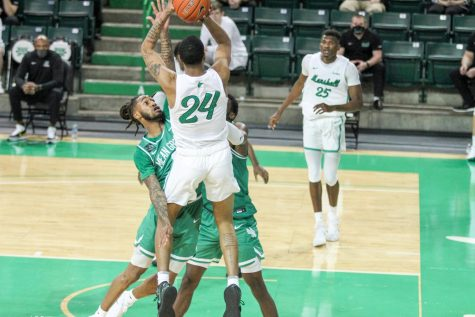 Junior guard Taevion Kinsey pulls up for a jumper against North Texas Saturday, Feb. 27. He scored 18 points, helping lead a Jarrod West-less Marshall basketball team to a 73-72 victory.