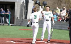 After his leadoff home run in the first inning, junior shortstop Geordon Blanton (3) is greeted at home plate by sophomore catcher Kyle Schaefer (34).