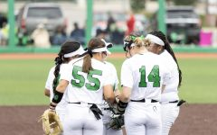 The Marshall infield gathers at the circle during a matchup with Bellarmine Saturday, March 27.