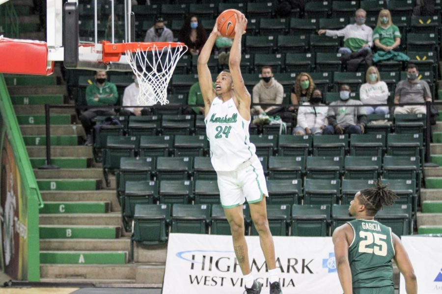 Junior guard Taevion Kinsey skies for a dunk during a 75-66 victory against Charlotte on Saturday, Mar. 6, the final game of the regular season.