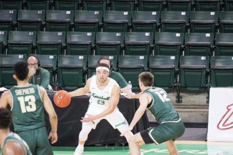 Senior guard Jarrod West dribbles the ball against Charlotte on Saturday, March 6.
