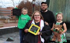 Brittany Hively, executive editor, and family prior to her winter 2019 graduation from Marshall University.