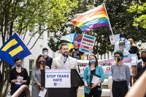 Alabama Rep. Neil Rafferty speaks in support of transgender rights during a rally outside the Alabama State House in Montgomery, Ala., on Tuesday, March 30, 2021. (Jake Crandall/The Montgomery Advertiser via AP)