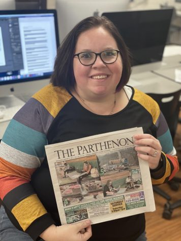 Brittany Hively, executive editor, in Parthenon newsroom with a print edition of the paper.