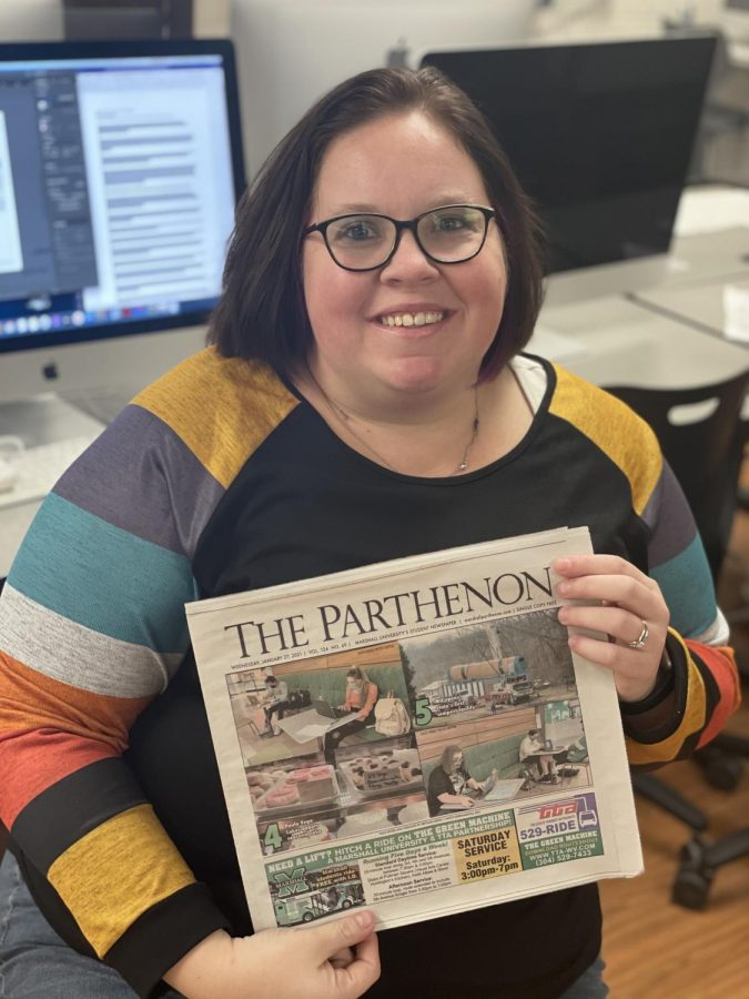 Brittany+Hively%2C+executive+editor%2C+in+Parthenon+newsroom+with+a+print+edition+of+the+paper.+