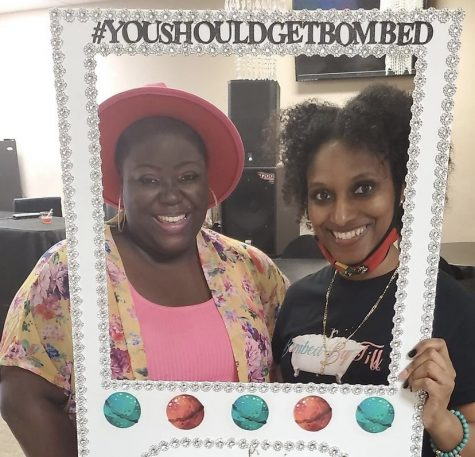 Tiffanie Nichole (right) takes photo with client (left) at a small business event. | Tiffanie Nichole