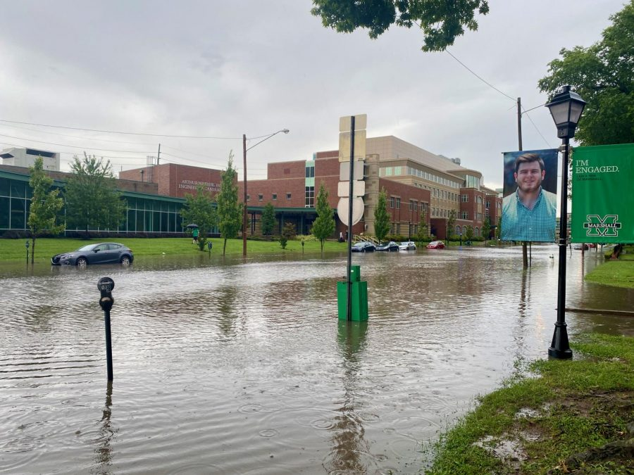 Flash flood makes third avenue impossible to drive during the storm