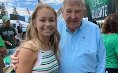 Student Body President, Alyssa Parks poses with notable alumni and former Navy coach Jack Lengyel at the Big Green Tailgate