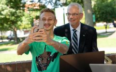 President Gilbert poses for a selfie while on campus