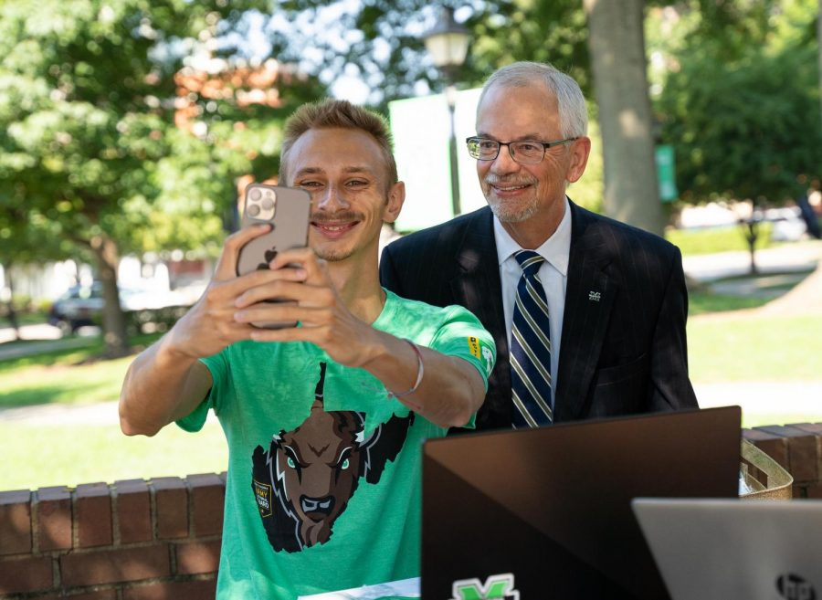 President+Gilbert+poses+for+a+selfie+while+on+campus