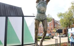 The statue, created by Huntington Native and Marshall graduate Frederick Hightower Sr., is a nearly eight-foot-tall bronze figure of Greer in his number 16 Marshall jersey. | Richard Crank