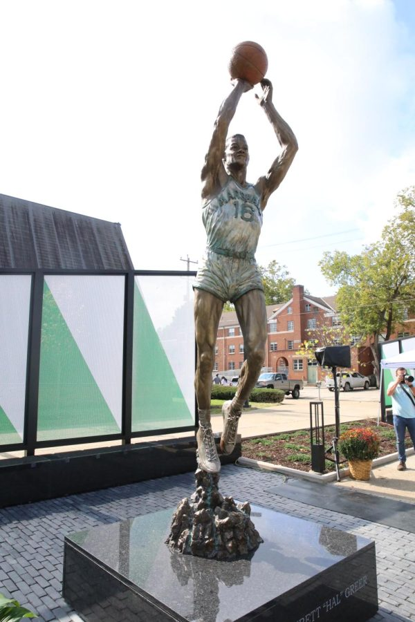 The+statue%2C+created+by+Huntington+Native+and+Marshall+graduate+Frederick+Hightower+Sr.%2C+is+a+nearly+eight-foot-tall+bronze+figure+of+Greer+in+his+number+16+Marshall+jersey.+%7C+Richard+Crank