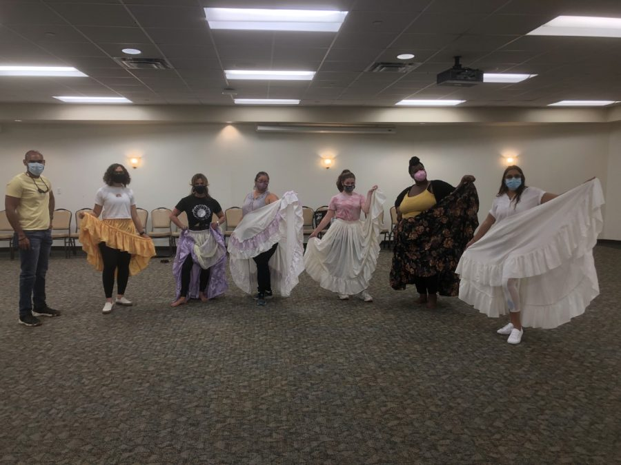 Dancers pose as they teach the Bomba